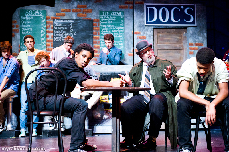 Pioneer Theatre Guild: West SideStory | Lt. Schrank (Charles White) tries to get Riff (Sena Adjei) and the other Jets to reveal where the rumble with the Sharks is going to be.