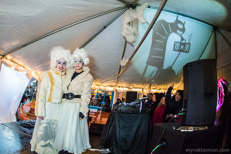 "FoolMoon 2014 | The DJ sister duo, Meryl and Leah Waldo kept the beats pumping all night. Meanwhile, Patrick Elkins's horned, cycloptic hunchback lends a competing groove to the scene — old-school, ghetto-blaster style. (Back in the day, we'd listen to music on ""tape."" Ask your parents.)"