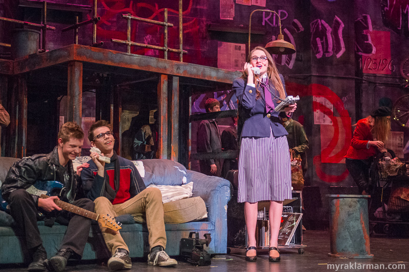 Pioneer Theatre Guild:Rent | Roger Davis and Mark Cohen (Nathan Stout and Remington Reackhof) laugh as they listen to a voicemail from Mark's ridiculously forthright mother, Mrs. Cohen (Emily Uhlmann).