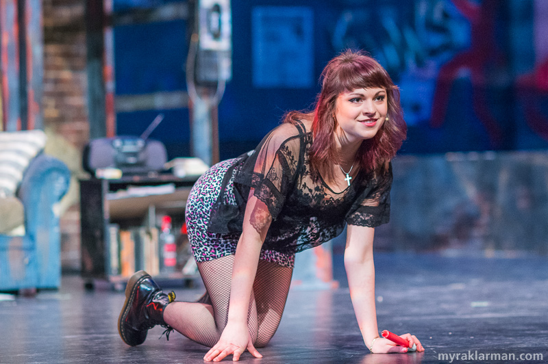 "Pioneer Theatre Guild: Rent | ""They say that I have the best ass below 14th Street. Is it true?"" Exotic dancer Mimi Marquez (Olivia Roumel) lightheartedly teases Roger Davis in the flirtatious number ""Light My Candle."""