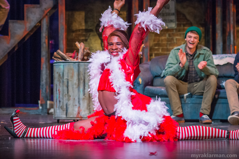Pioneer Theatre Guild:Rent | And what would a killer musical number be without the perfect finishing touch? Angel (Robbie Stephens) effortlessly hits the final pose of the number — splits! — as Tom Collins (Caleb Horvath) watches fondly.