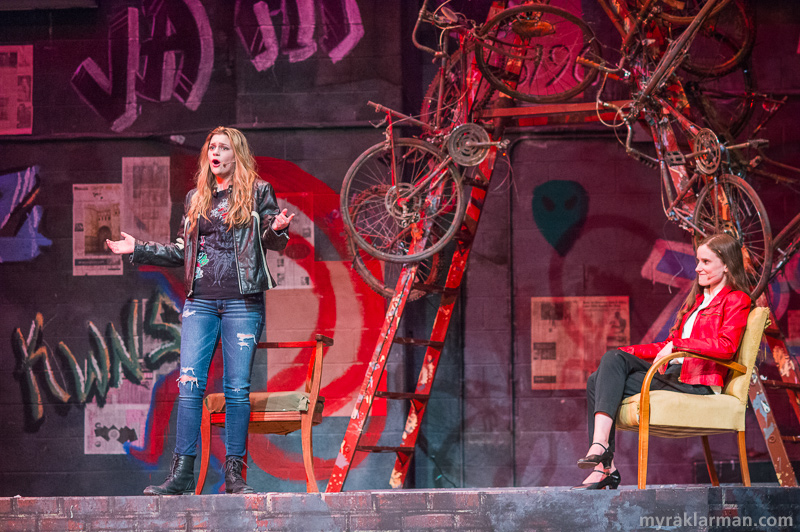 "Pioneer Theatre Guild: Rent | Trouble in paradise: After a relatively smooth patch in their relationship, Maureen and Joanne (Rose Meehan and Adriana Ellis) hit the rocks again. In ""Take Me Or Leave Me,"" the incredibly talented duo belt — and out-belt! — each other."