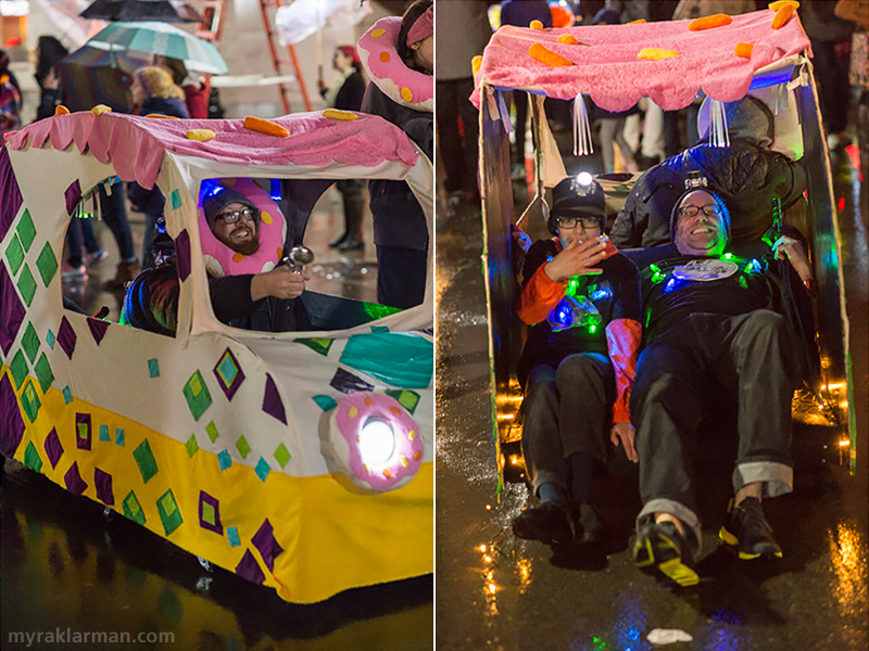 FoolMoon 2015 | Natalie Berry and Trevor Stone brought their super-pimped-out ride to FoolMoon. Here, Trevor sounds the horn as the car lurches down Washington Street, through the courtesy of Max and Rico's four feet.