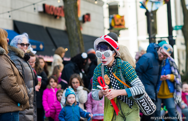 FestiFools 2016 | Max and Rico did their clown antics up and down Main St. Here, the shtick is Max hypnotizing Rico — making him fall asleep on the asphalt, bark like a dog, sleepwalk, etc. The kids LOVED it!