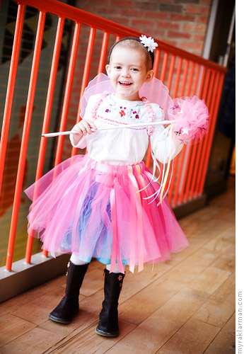 Make-A-Wish: PrincessIzzy | Izzy models her fairy dress-up ensemble, which includes a skirt, wings, and wand. I love how the skirt is designed to go over her clothes.