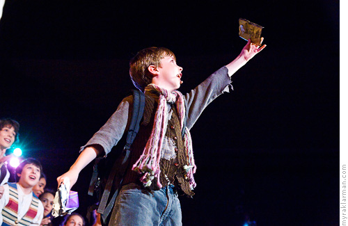 Pioneer Theatre Guild: Willy Wonka | Charlie (Milo Tucker-Meyer) has a golden ticket! And he's sure to steal your heart.