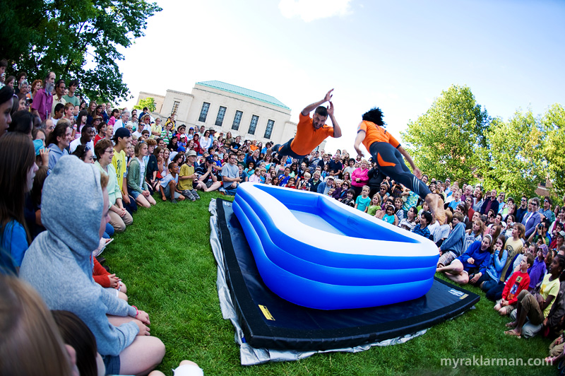 "Ann Arbor Summer Festival 2008 | STREB's crowd teaser/pleaser: I'm pretty sure I heard the guy yell ""this is gonna hurt!"" as he hurled himself into the kiddie-size, inflatable pool. I was forced to use my body as a human shield to protect my Nikon D3 from the seemingly interminable onslaught of splashes that ensued. Cannonball!!!"