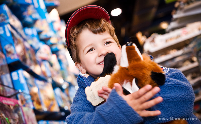 Play It Safe | One of my models poses with a very cuddly fox at Tree Town Toys, which generously opened up its warehouse and allowed the Ecology Center to test toys that were not found at the big box stores.