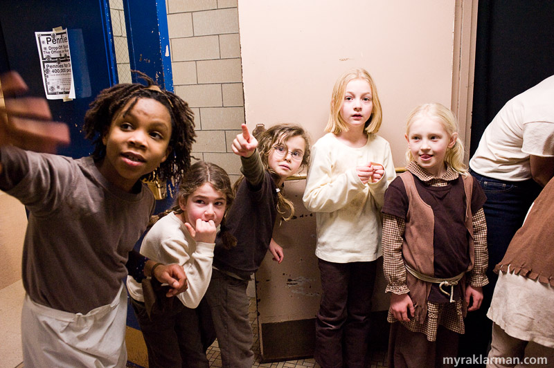 Burns Park Players: Annie Get Your Gun | Second grade girls awaiting their cue in the stairway spot Annie offstage.