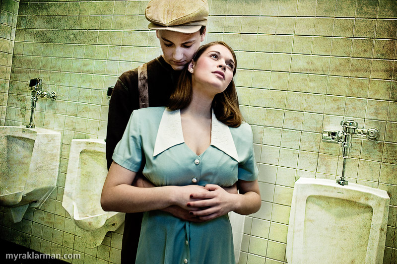 Pioneer Theatre Guild: Urinetown (Publicity Shoot) | The poor revolutionary Bobby Strong (Robby Eisentrout) and the rich tycoon's daughter Hope (Mara Abramson) are in love. Now before I get anybody in trouble, I want to clearly state: the boys' bathroom, while not the cleanest facility I've been in, was not remotely as dirty as you see here. The problem — and for purposes of the publicity shoot this actually was a problem! — was that the bathroom was too clean. So I employed several tricks in post-production to achieve the desired level of skankiness.