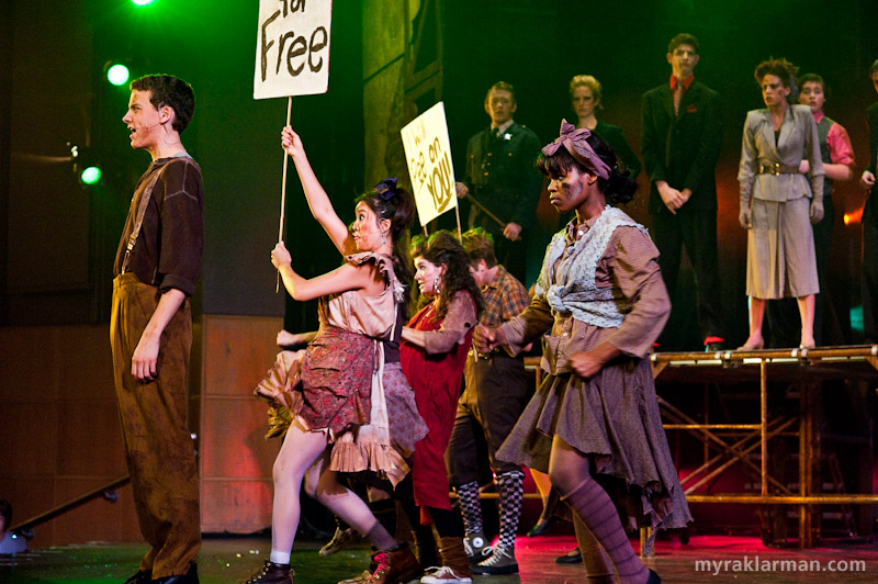 "Pioneer Theatre Guild: Urinetown | Act 1 Finale brings the entire cast onto the stage. The ""Pee for Free"" revolutionaries throw off the shackles of economic oppression, while the forces of darkness — or so it would seem — look on from above."