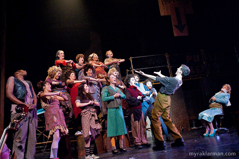 Pioneer Theatre Guild: Urinetown | Bobby Strong (Robby Eisentrout) leads a paupers' choir in one of my favorite numbers, Run Freedom Run.