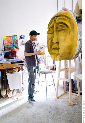 FestiFools April 1st Parade | U-M Senior Sung Hei Yau paints a puppet head.