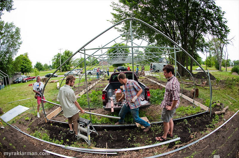 Hoop House Dreams | An overview of the hoop house in progress, with some of the 40 volunteers who helped build it.