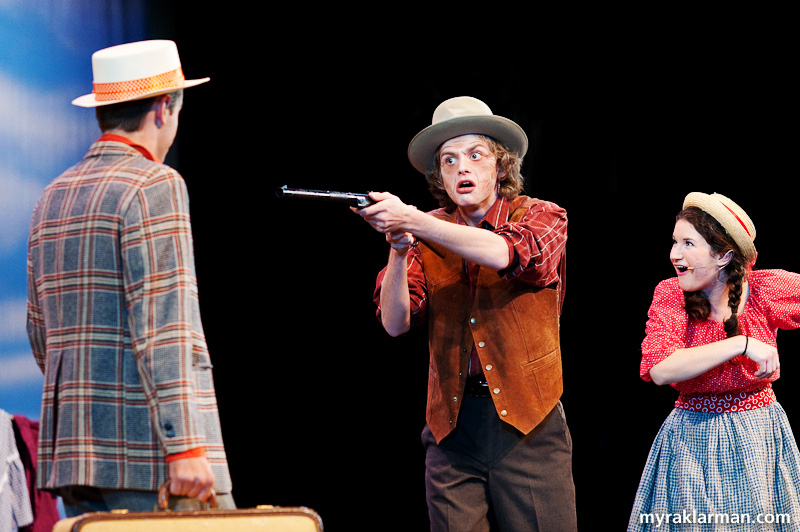 Pioneer Theatre Guild: Oklahoma! | Mr. Carnes (Daniel Mozurkewich) forces Ali Hakim (Leo Bayless-Hall) to marry his daughter, Ado Annie (Maia Gleason), at gunpoint.