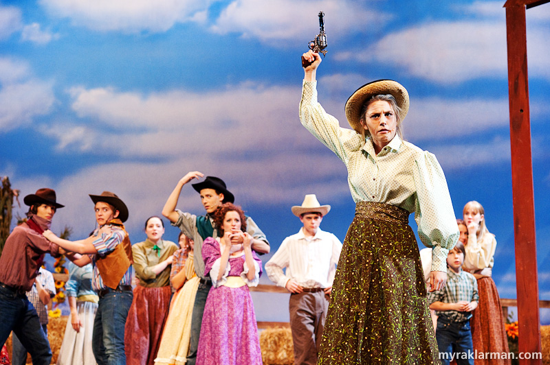 Pioneer Theatre Guild:Oklahoma! | Aunt Eller (Emily Steward) imposes peace between the cowboys and the farmers.