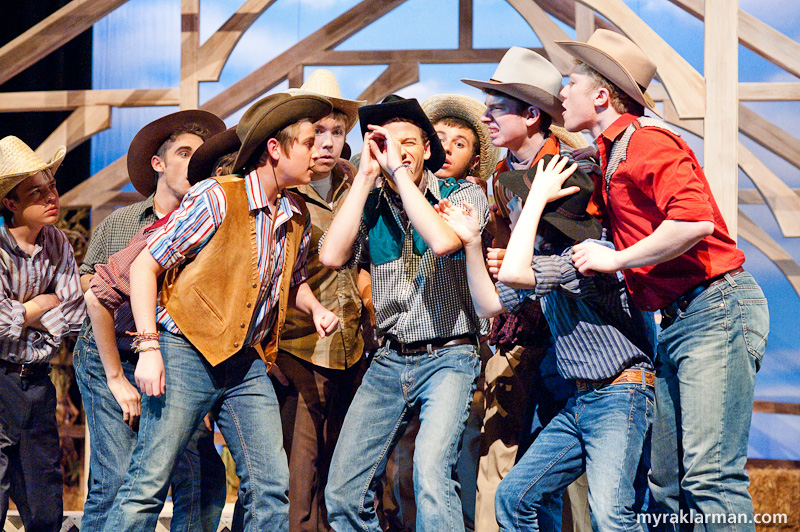 Pioneer Theatre Guild:Oklahoma! | The boys enjoy a close look at one of Will's souvenirs from Kanses.