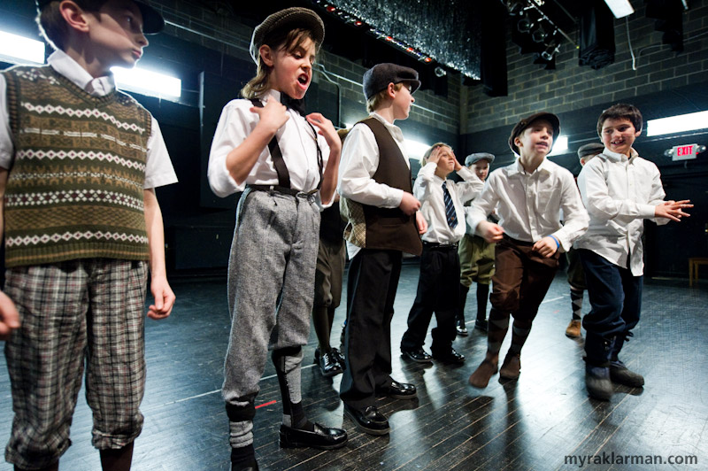 Burns Park Players: Guys andDolls | Fourth-grade, knickerbocker-clad boys horsing around — er, getting in touch with their characters' NYC moxie — during a rehearsal.