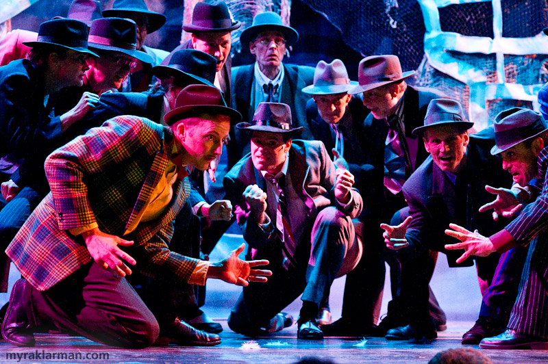 Burns Park Players: Guys andDolls | Dress rehearsal of the crapshooters dance. Staged and lit like a Diego Rivera mural.