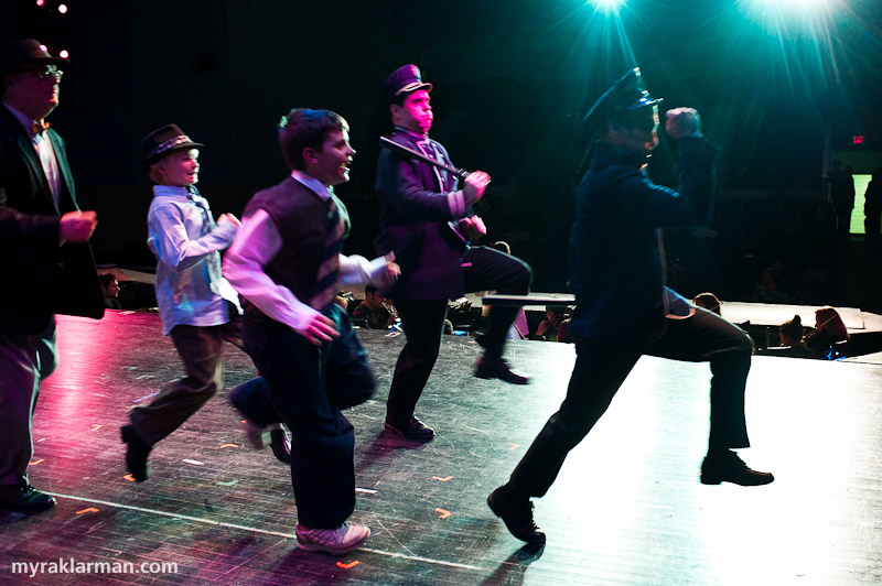 Burns Park Players: Guys andDolls | One of my favorite moments in the show to photograph from upstage: two policemen (Fred Hall and Steve Gradwohl), two fifth-grade boys, and the victim (Alan Dengiz) chase a pickpocket.