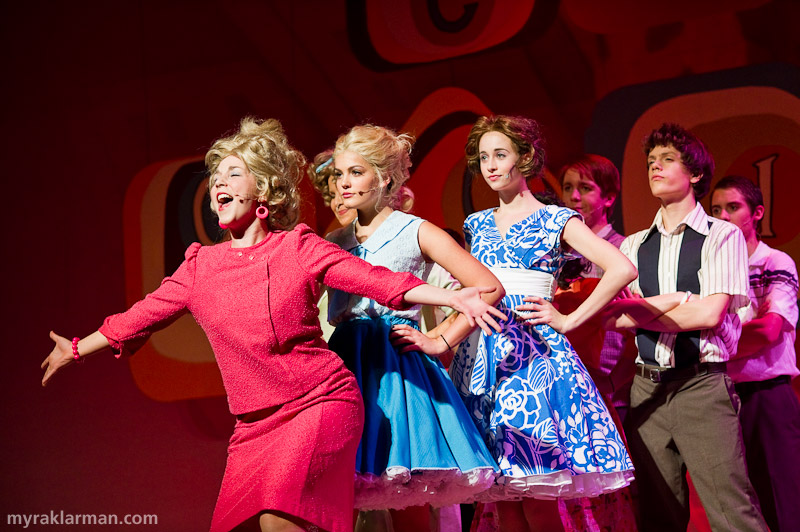 "Pioneer Theatre Guild: Hairspray | Velma Von Tussle (Victoria Reackhof) somewhat skankily reminisces of her past glories as ""Miss Baltimore Crabs."" Amber Von Tussle (Carlina Paull-Baird) expects to follow in her mother's footsteps, and be crowned Miss Hairspray."