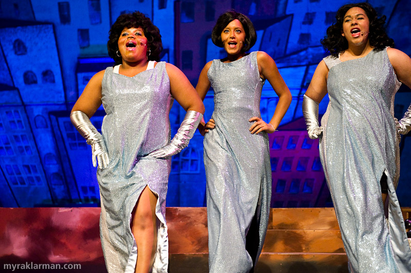 "Pioneer Theatre Guild: Hairspray | The lovely Dynamites (Aina Kelsaw-Fletcher, Mai Jammeh, and Taryn Thomas) provide the soundtrack, ""Welcome to the 60s,"" as Edna (after being a shut-in for several years) finally ventures out into the world."