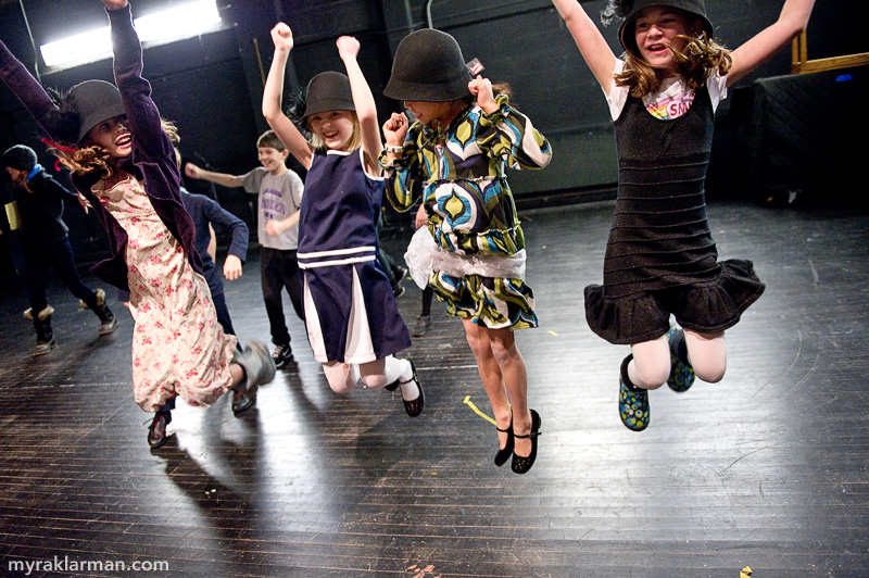 Burns Park Players: Getting Ready to Succeed! | The fourth grade girls cheer for the Old Ivy Groundhogs from the sidelines. The aerodynamic properties of their 1920s flapper hats really help them fly!