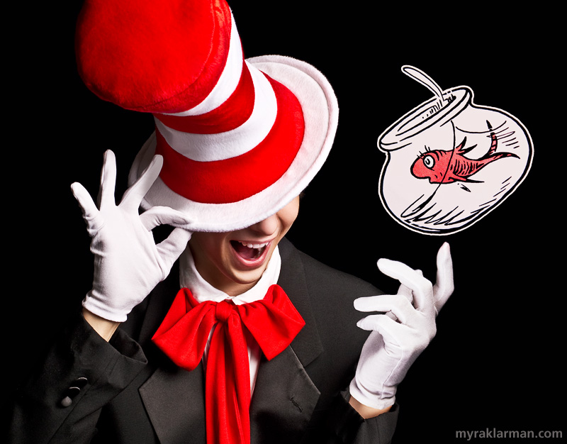 Pioneer Theatre Guild: Seussical (Publicity Shoot) | It's obviously the Cat in the Hat, but the press photo aims to keep the exact look of the character hidden, um, under his hat. (Goldfish appears courtesy of Atlantic Records.)